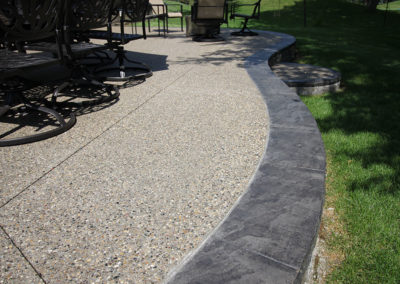 Exposed Aggregate Patio with Stamped Concrete Border and Facing