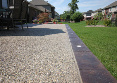 Exposed Aggregate Patio With Lights in Border